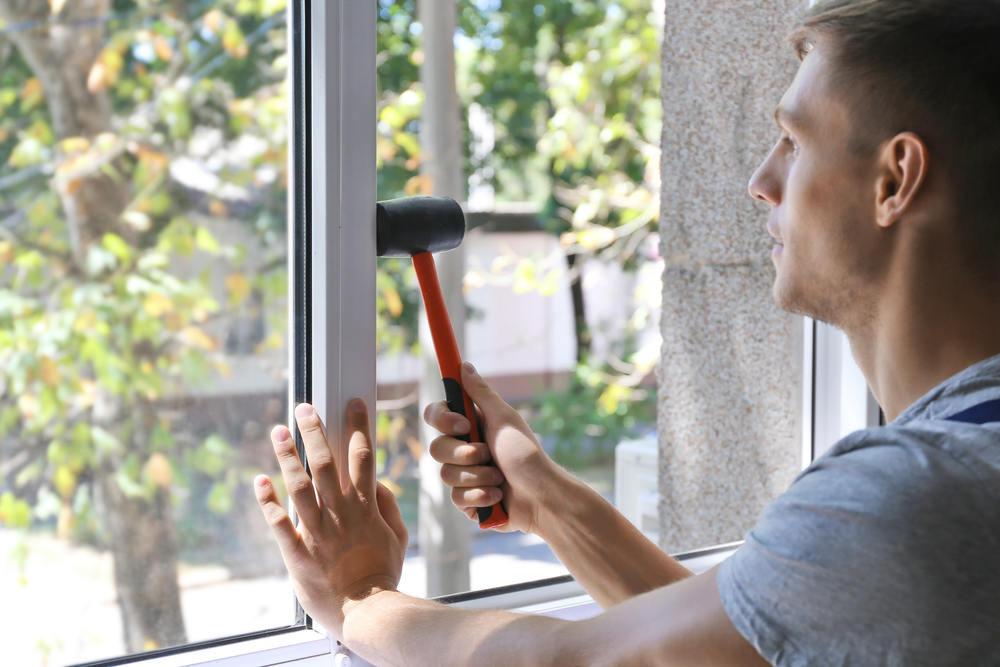 Window installer replacing window (You're Replacing Your Windows & Doors – Now What)