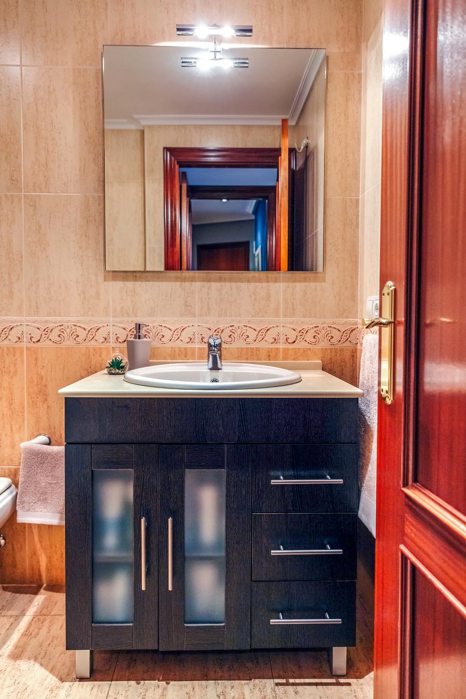 Bathroom with washbasin cabinet and mirror